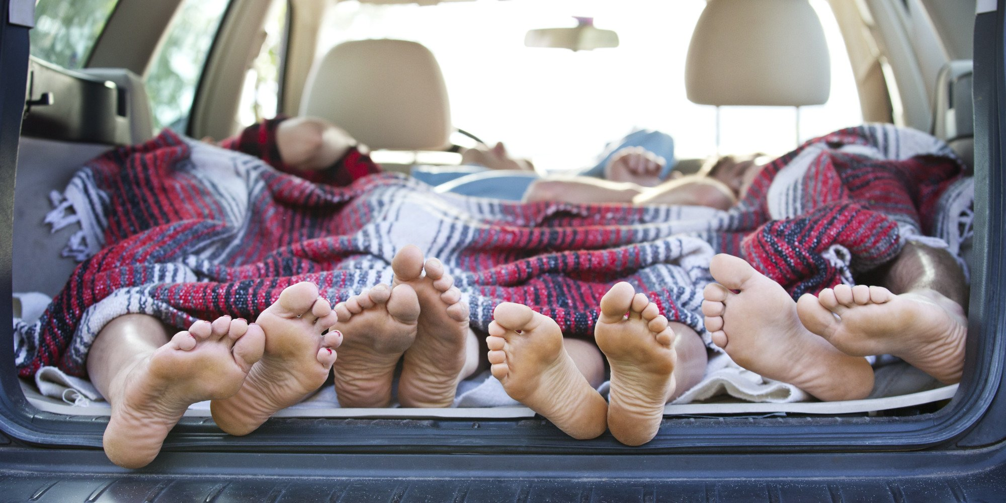 Campers' Feet Sticking Out of a Station Wagon